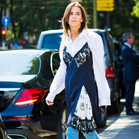 how to wear a slip dress in autumn winter:  A slip dress worn over jeans and a white shirt