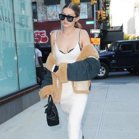 how to wear a slip dress in autumn winter:   Gigi Hadid wearing a Victoria Beckham slip dress