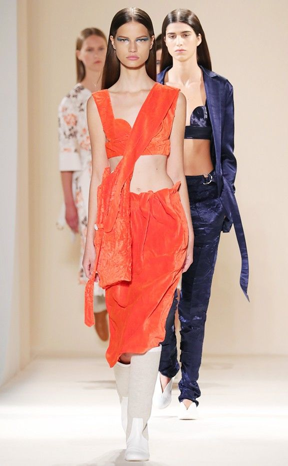 A velvet bralette and skirt in a burnt orange hue.
