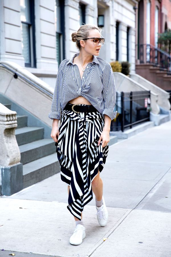 On Testoni:Loewe Filipa Sunglasses ($520), Tome Baja Stripe Skirt ($850).
