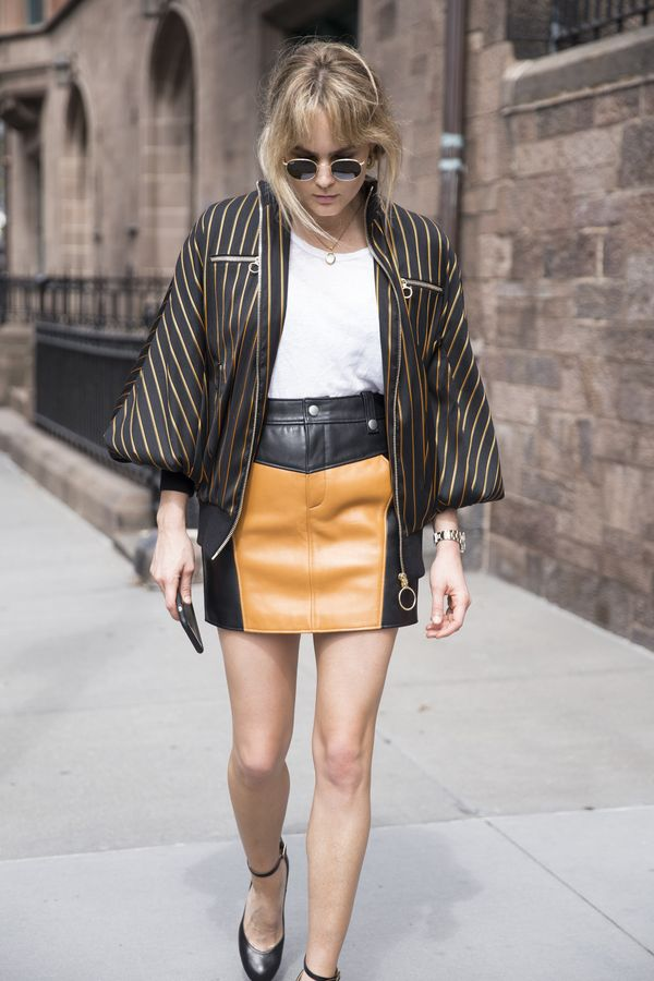 On Testoni: Zimmermann Lavish Track Bomber Jacket ($1350), James Perse T-Shirt ($169), Coach leather skirt, Chloé heels, Ray Ban Round Metal Sunglasses ($270).