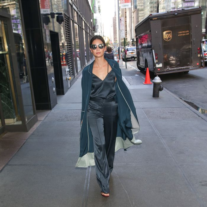 Lily Aldridge wears a duster coat by La Ligne while out in New York City.
