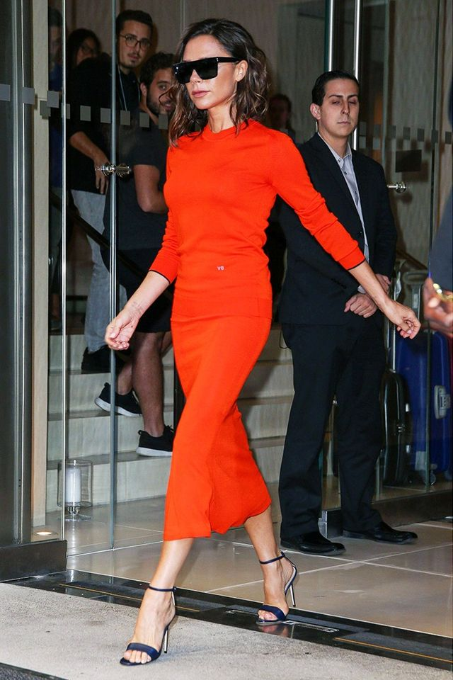 Style Notes: While this is a bold colour for anyone, not just Beckham, this simple dress looks totally chic with the barely there sandals.