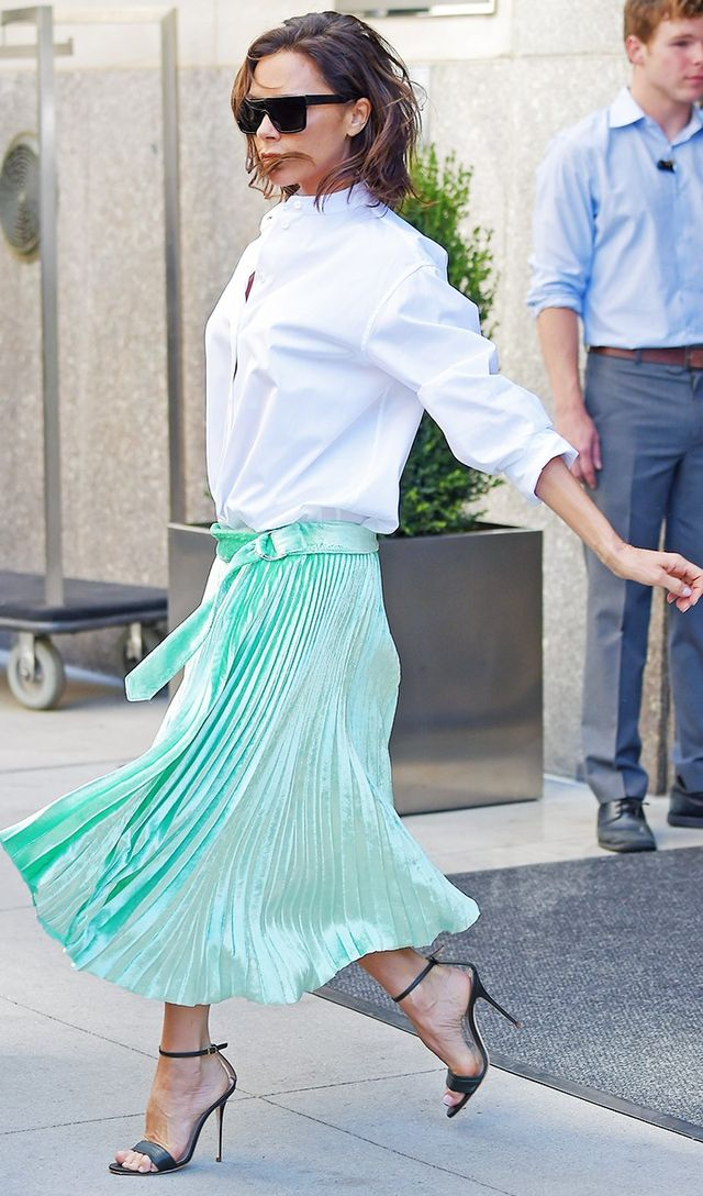 Style Notes: While she's gone for her signature white shirt, she's paired it with one of her pleated green velvet skirts from the new collection she just showed at New York Fashion...