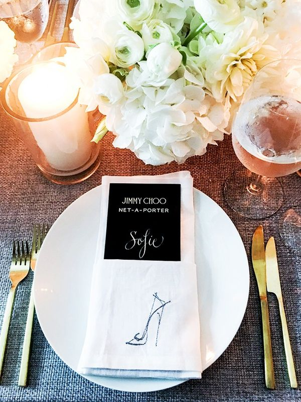 """""""The Jimmy Choo dinner had the cutest table setting ever, with lots of golden, pink and white details—in short: every girl's dream."""""""