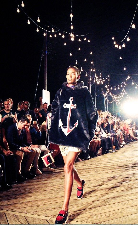 """""""The amazing carnival-inspired Tommy Hilfiger show, featuring a huge Ferris wheel, a gazillion lights, old-school neon signs, some really great snacks, and an impressive front row."""""""