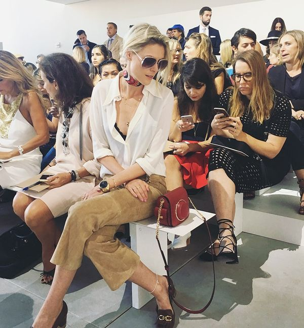 """""""Waiting for the Michael Kors show to start, wearing a head-to-toe look by the designer himself."""""""