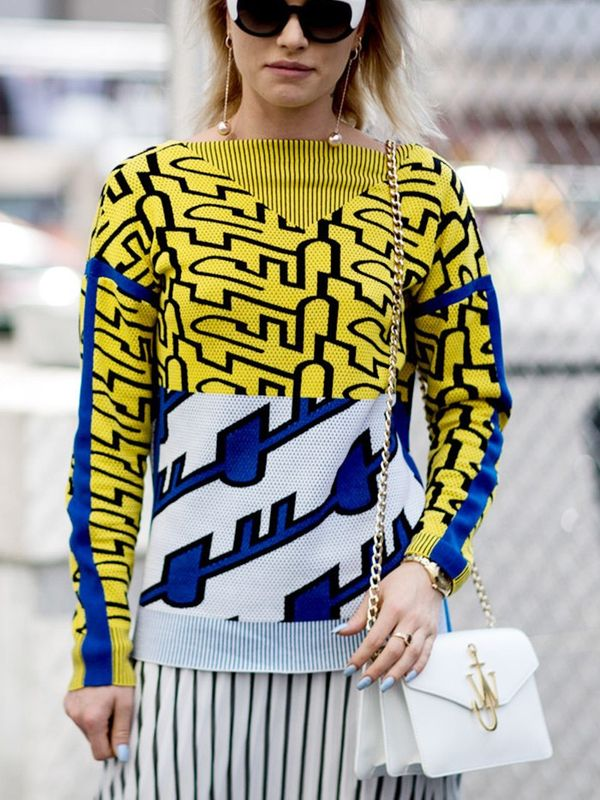 Wear Them With: Printed sweater + pleated skirt