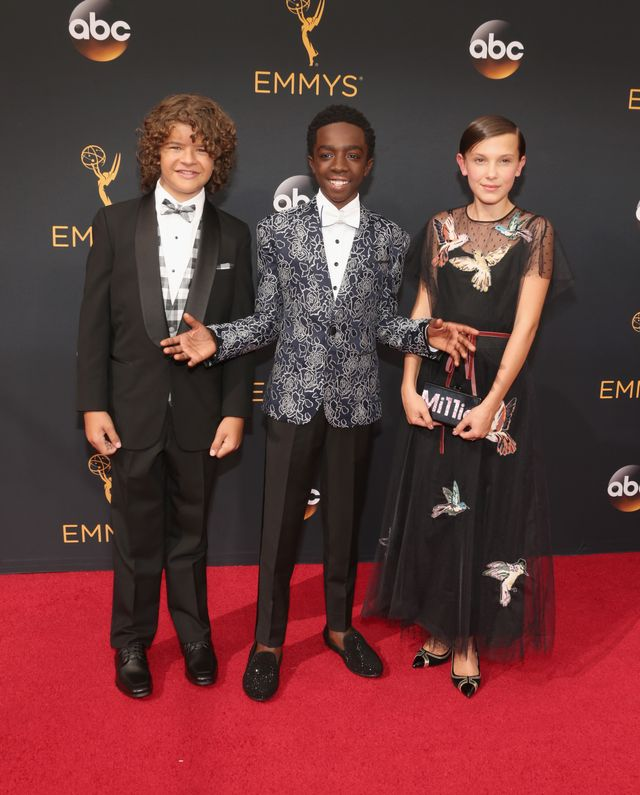 On Millie Bobby Brown: Red Valentino dress; Edie Parker clutch. Want more inspiring Emmys style? Check out all the looks everyone will be talking about!