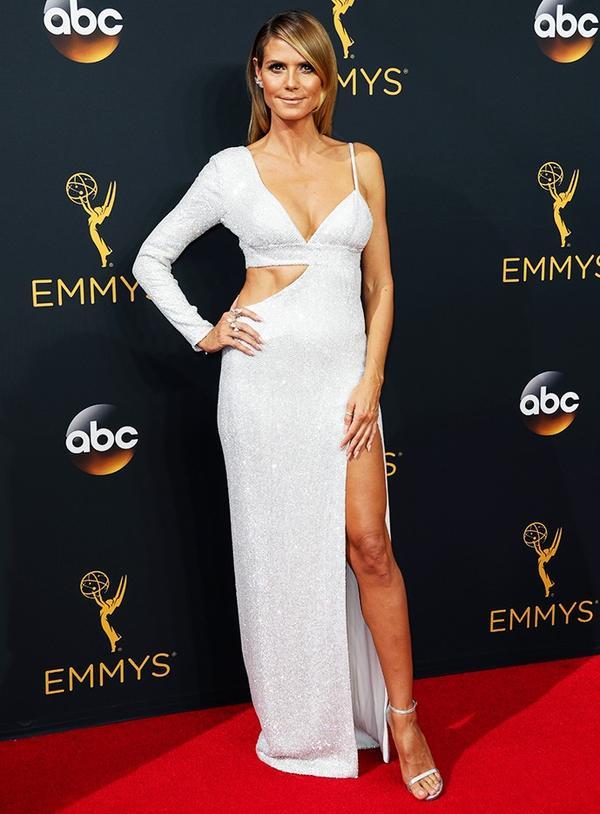 WHO: Heidi Klum WEAR: Michael Kors custom white diamond pavé silk-crêpe cutout gown.