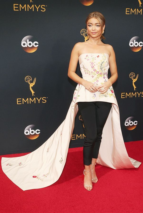WHO: Sarah Hyland WHAT: Actress, Modern Family WEAR: Monique Lhuillier Resort 16 cream faille floral-embroidered peplum bodice with floor-length train and black matte crêpe pants; Jimmy...