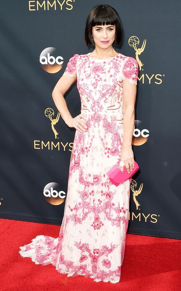 WHO: Constance Zimmer WHAT: Nominee, Outstanding Supporting Actress in a Drama Series, UnReal WEAR: Monique Lhuillier S/S 16 magenta lattice floral-embroidered lace gown.