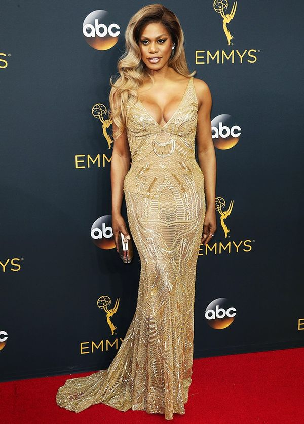 """WHO: Laverne Cox WHAT: Presenter and actress, Orange Is the New Black WEAR: Naeem Khan dress; Atelier Swarovski gold leather wrapped """"Cosmic"""" clutch."""