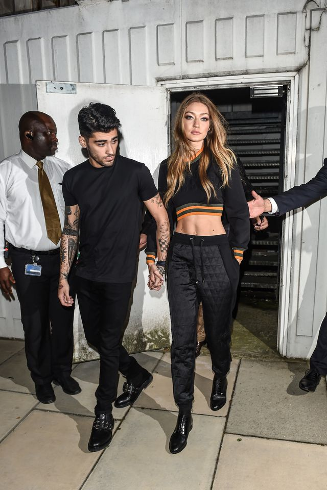 On Gigi Hadid: Versus by Versace sweatshirt and sweatpants. Hadid rocked a Versace look of a sweatshirt and track pants from the show to a nightclub with her sister.