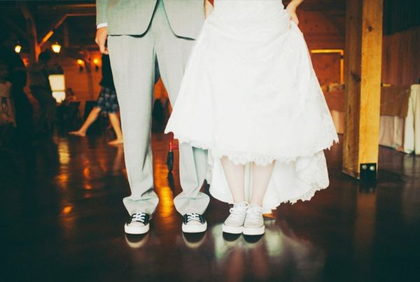 Bride wearing wedding dress and converse.