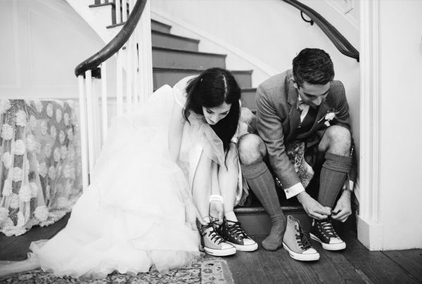 Bride and groom wearing converse