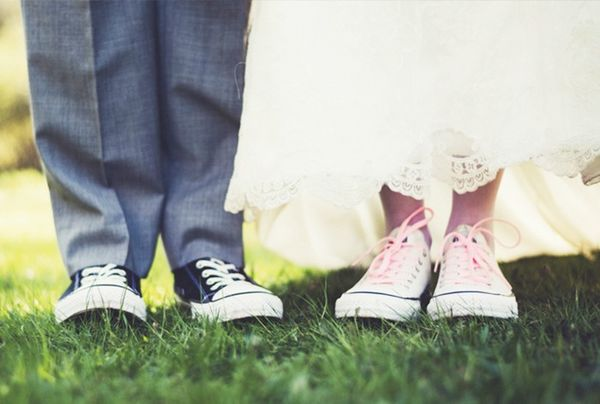 Wedding dress and converse sneakers.