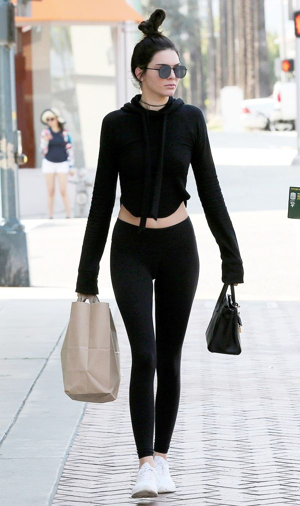 On Kendall Jenner:Elizabeth and JamesWatts Aviator Metal Sunglasses($195); Are You Am ICroft Hoodie($179); Alo YogaHigh Waist Airbrushed Leggings($82).