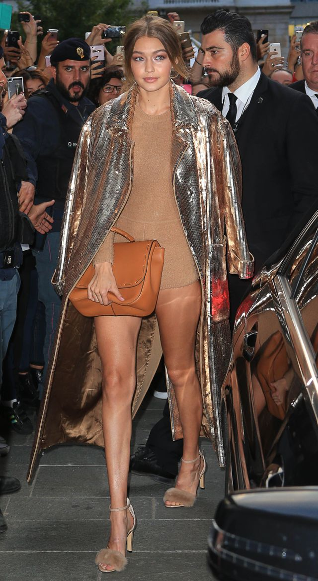 On Gigi Hadid: Max Mara Fall 2016 bodysuit, bag, Sandals($635).