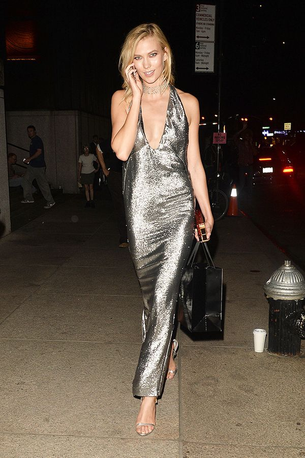 On Karlie Kloss: Tom Ford Lipstick Box Clutch ($3950) and Metallic Sandal ($1190); H.Stern necklace.