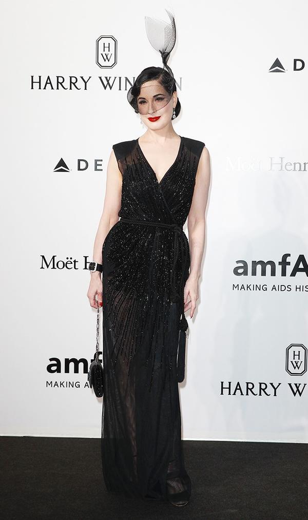 WHO: Dita Von Teese WEAR: Hood London fascinator;Elisabetta Franchi gown.