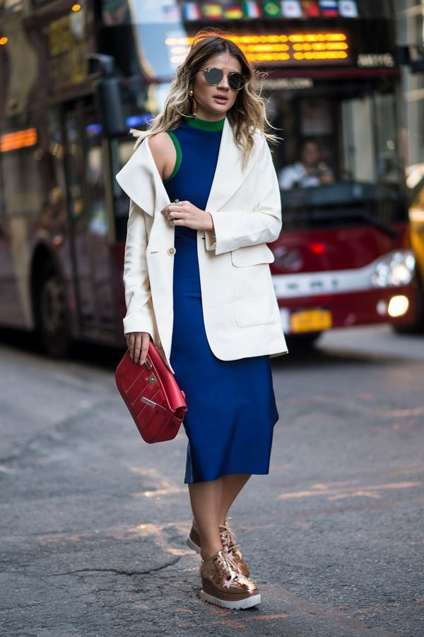 Dress up a sporty dress for work with a white crisp blazer.