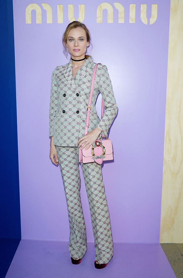 WHO: Diane Kruger WHAT: Miu Miu S/S17 show WEAR: Miu Miu suit and bag.