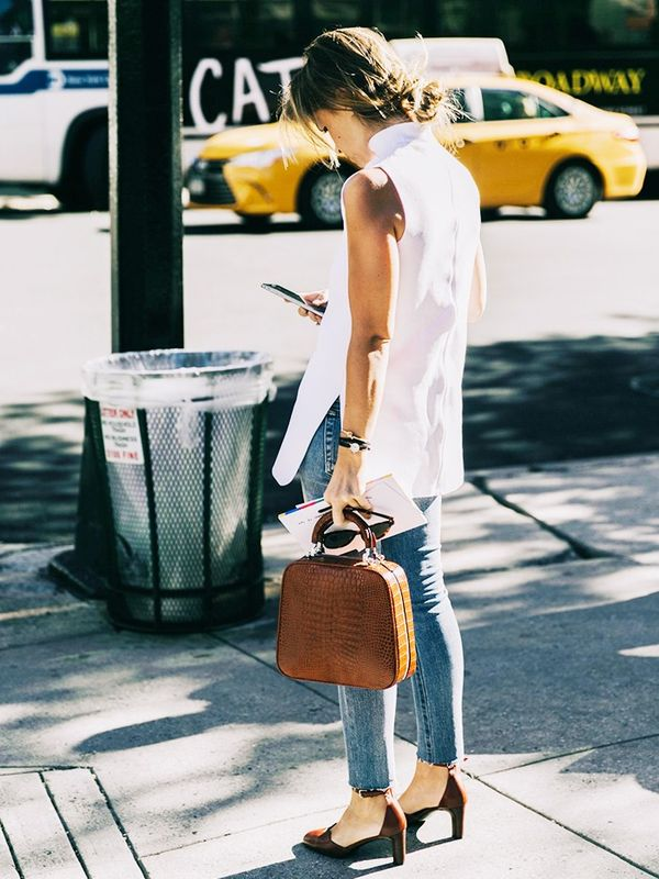 Street style unhemmed skinny jeans and heels