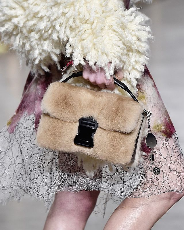 Furry bags were spotted all over F/W 16 catwalks, like Christopher Kane (above), Fendi, and Alexander Wang. This playful purse is a quick way to add a tactile element to your look.