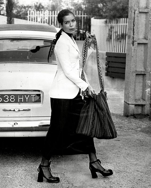 If we've learned anything about Bianca Jagger's style, it's that she knows how to rock a white blazer. But she also happens to be skilled at the art of accessorizing, as witnessed above.