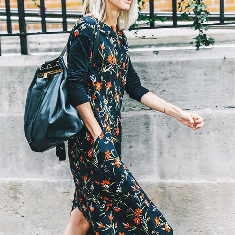 Pair a dark floral dress with moto boots.