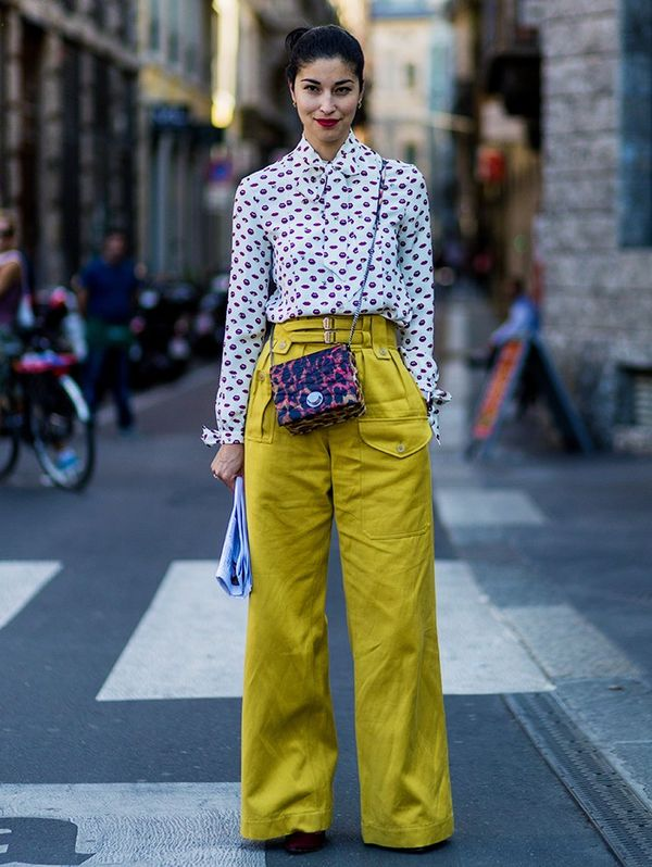 Style Notes: Caroline Issa treats her mustard pants as a kind of neutral piece, pairing wild prints together around it. A fabulous option for when you're bored with navy and black staples.
