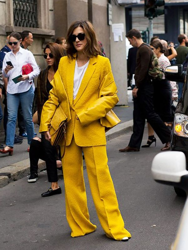 Style Notes: Eleonora Carisi isn't holding back on her love for the mustard. When the shade suits brunettes so much, why not?