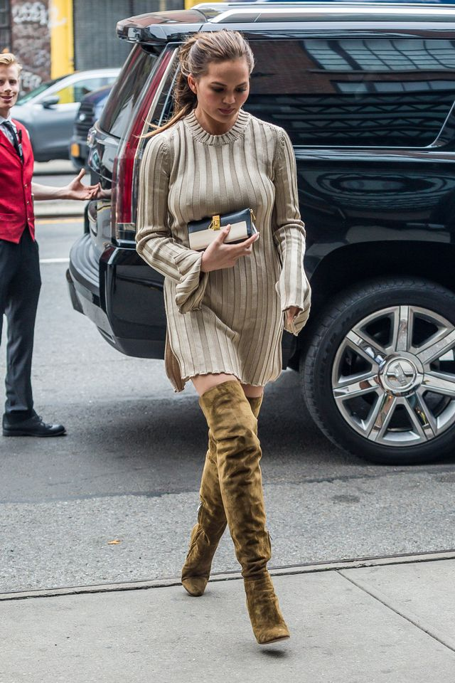 Chrissy Teigen street style sweater dress over the knee boots