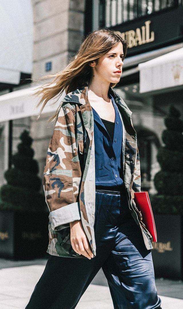 Camouflage jacket, fashion week street style.