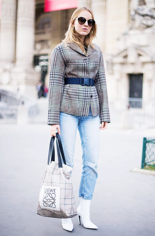 What better way to accessorize your belted blazer, light-wash jeans, and white boots ensemble than with a cool Loewe tote?