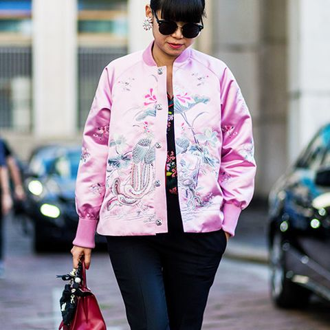 A silk pink bomber jacket will never go out of style.