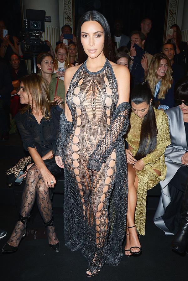 WHO: Kim Kardashian West WHAT: Balmain S/S 17 show WEAR: Balmain dress; Sophia Webster shoes.