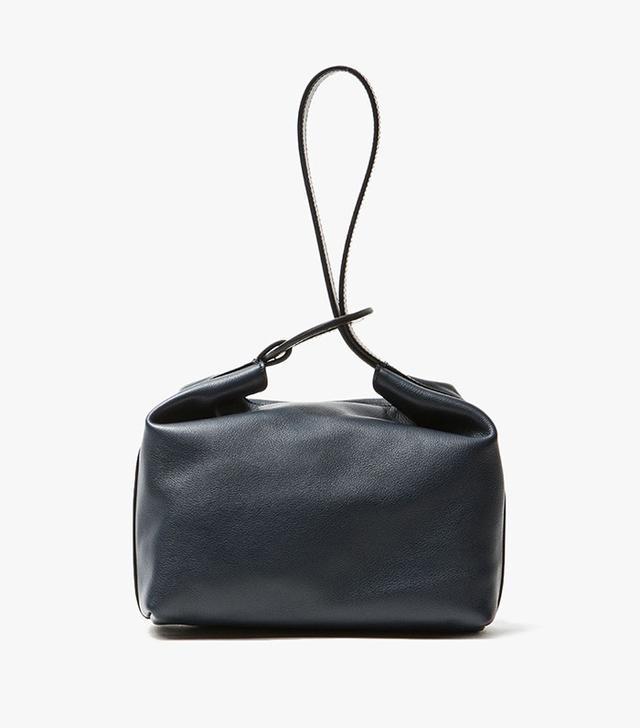 Trademark Reed Wrist Bag