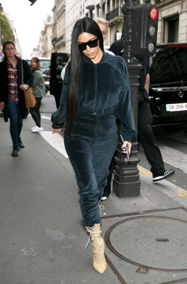 On Kardashian West:Adidas tracksuit, Yeezyboots.