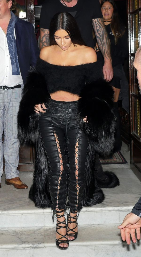 On Kardashian West: Givenchy coat, Unravel pants, Tom Ford heels.