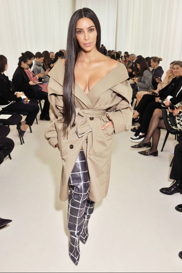 On Kardashian West: Balenciaga trench coat and boots.