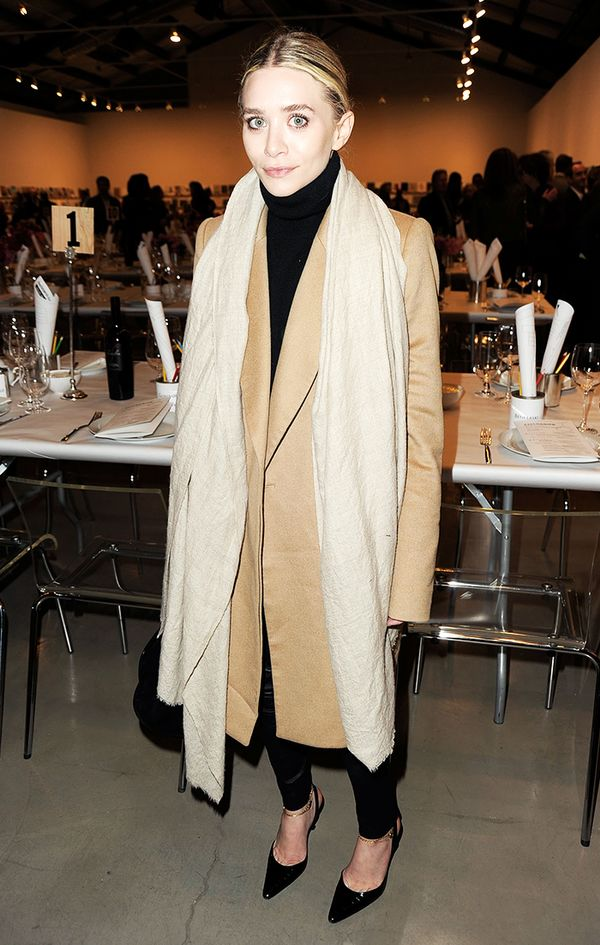 Ashley Olsen wearing camel coat and scarf
