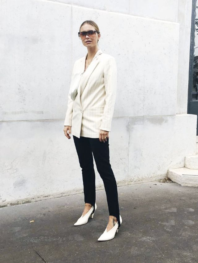 Style Notes:The white shoesand blazer give the leggings a high-fashion look, plus the added detail of the stirrups on the trousers also give the overall outfit more style.