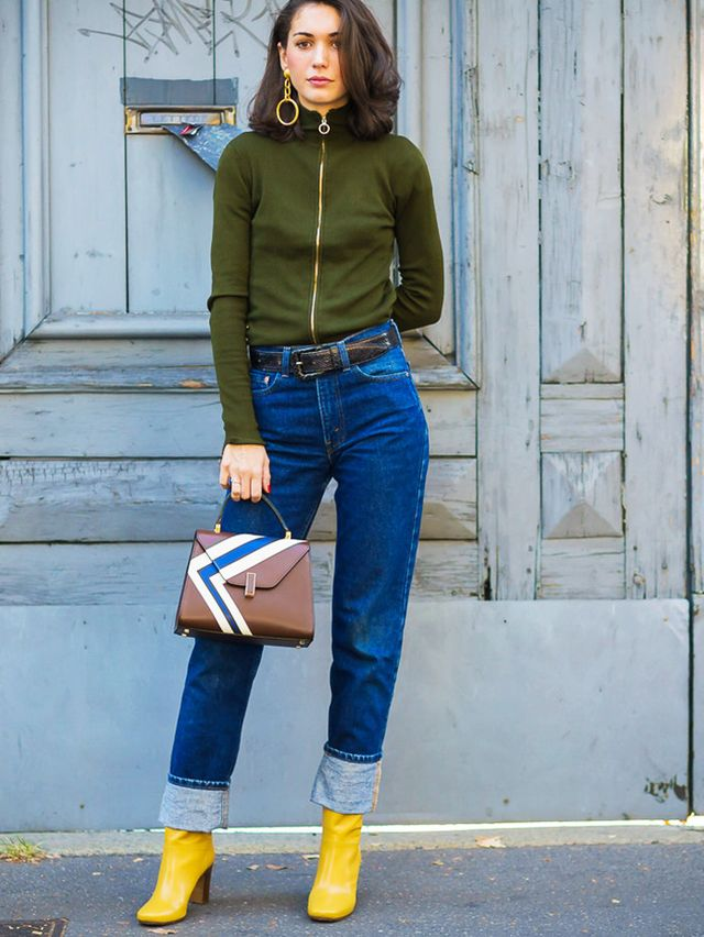 Style Notes: We wouldn't have thought of wearing major denim turn-ups with a pair of bright boots peeking out underneath, but how casual does it look when paired with a simple, sporty zip-up...