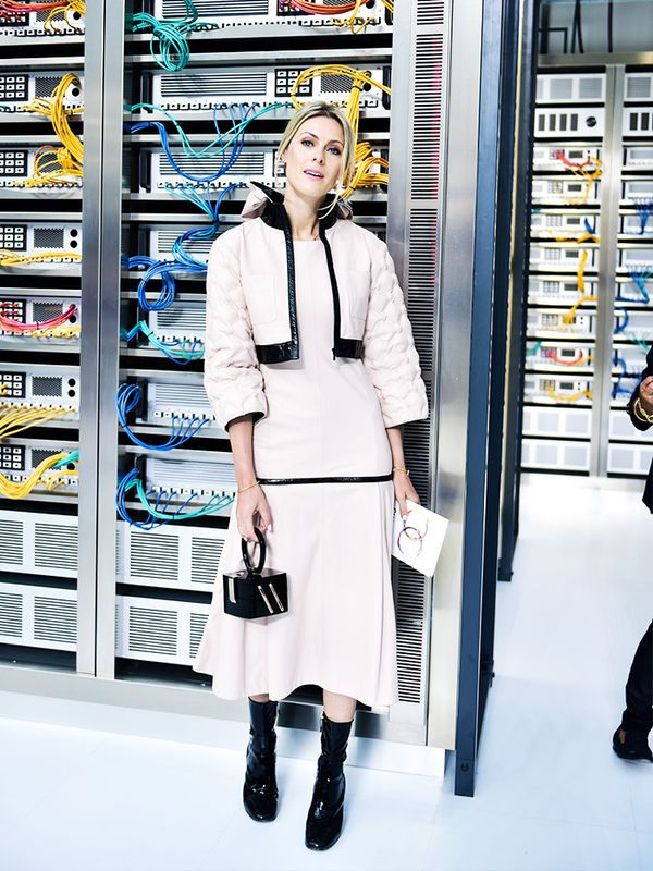 """Getting lost in Karl's colourful high-tech world in a head-to-toe Chanel outfit of a baby pink maxi dress with matching jacket, patent leather booties and the cutest little minaudière..."