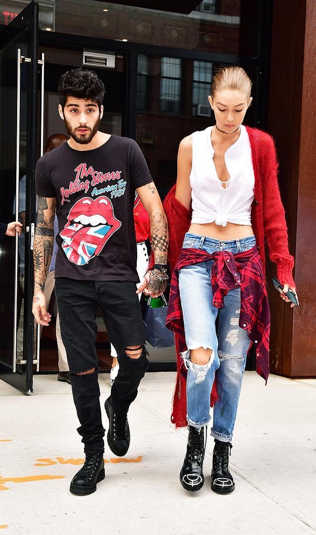 Gigi Hadid wearing boyfriend jeans long jacket street style
