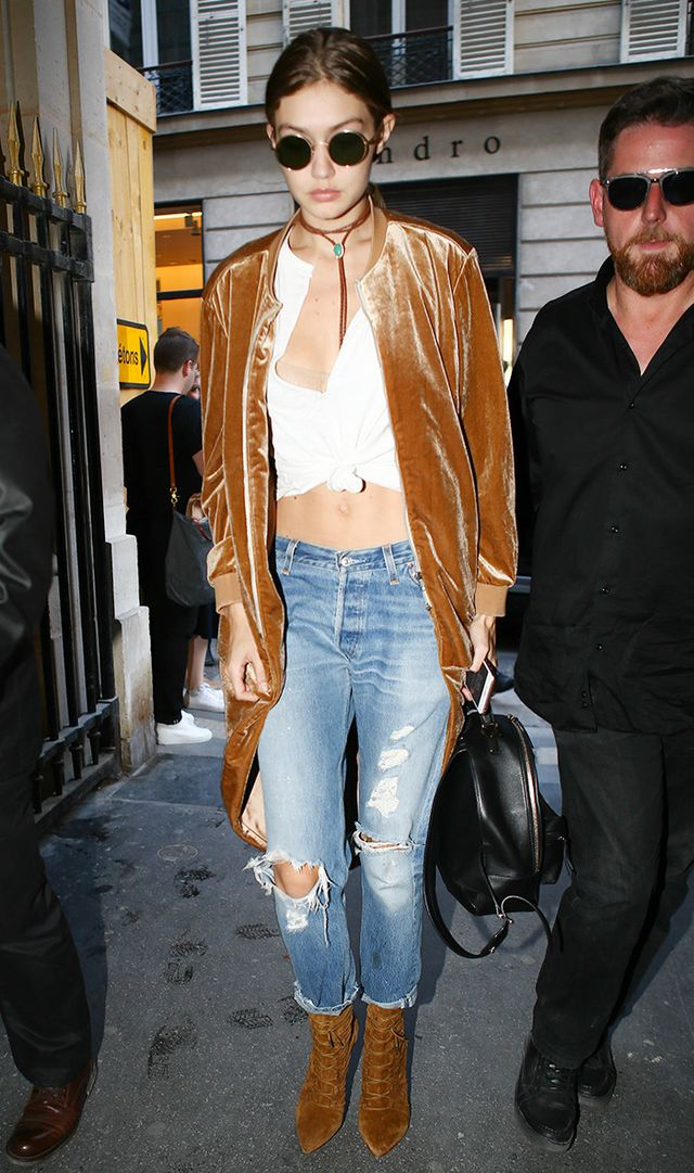 Gigi Hadid wearing velvet jacket and jeans