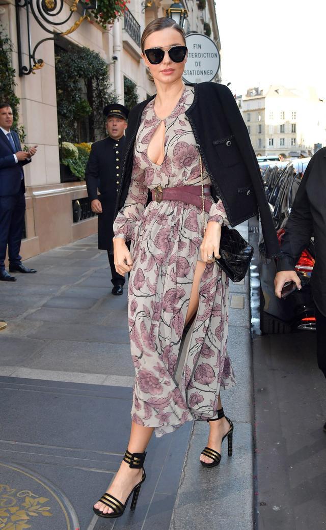 On Miranda Kerr: Céline sunglasses; Chanel jacket; Burberry Prorsum F/W 14 dress; Saint Laurent Serpet Monogram Belt ($395) and Paloma sandals; Chanel bag.