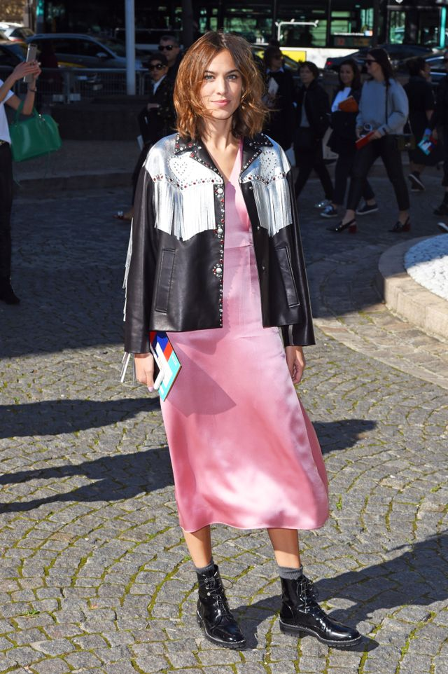 Alexa Chung wore a fringed leather jacket and baby-pink slip dress with black ankle boots to the final show of Paris Fashion Week, Miu Miu.